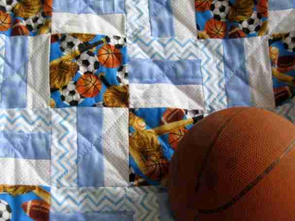 A baby handmade quilts for boys, personalized sports themed quilts for boys, babies  quilts handmade or boys who love sports